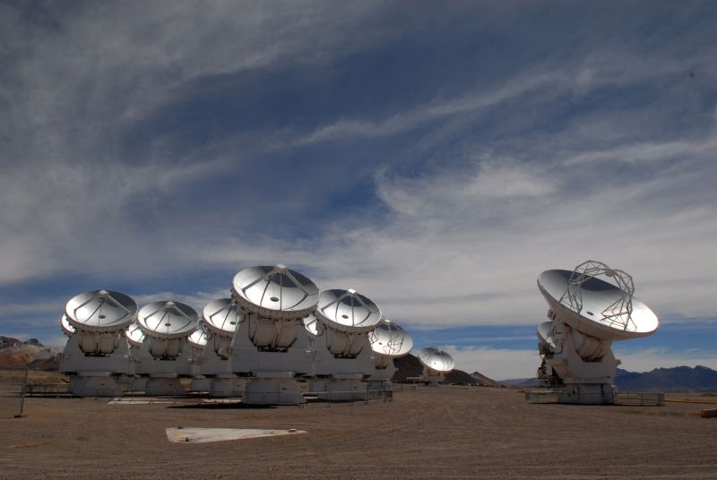 The ALMA array in Chile. Once ALMA was added to the Event Horizon Telescope, it increased the EHT's power by a factor of 10. - Image Credit: ALMA (ESO/NAOJ/NRAO), O. Dessibourg