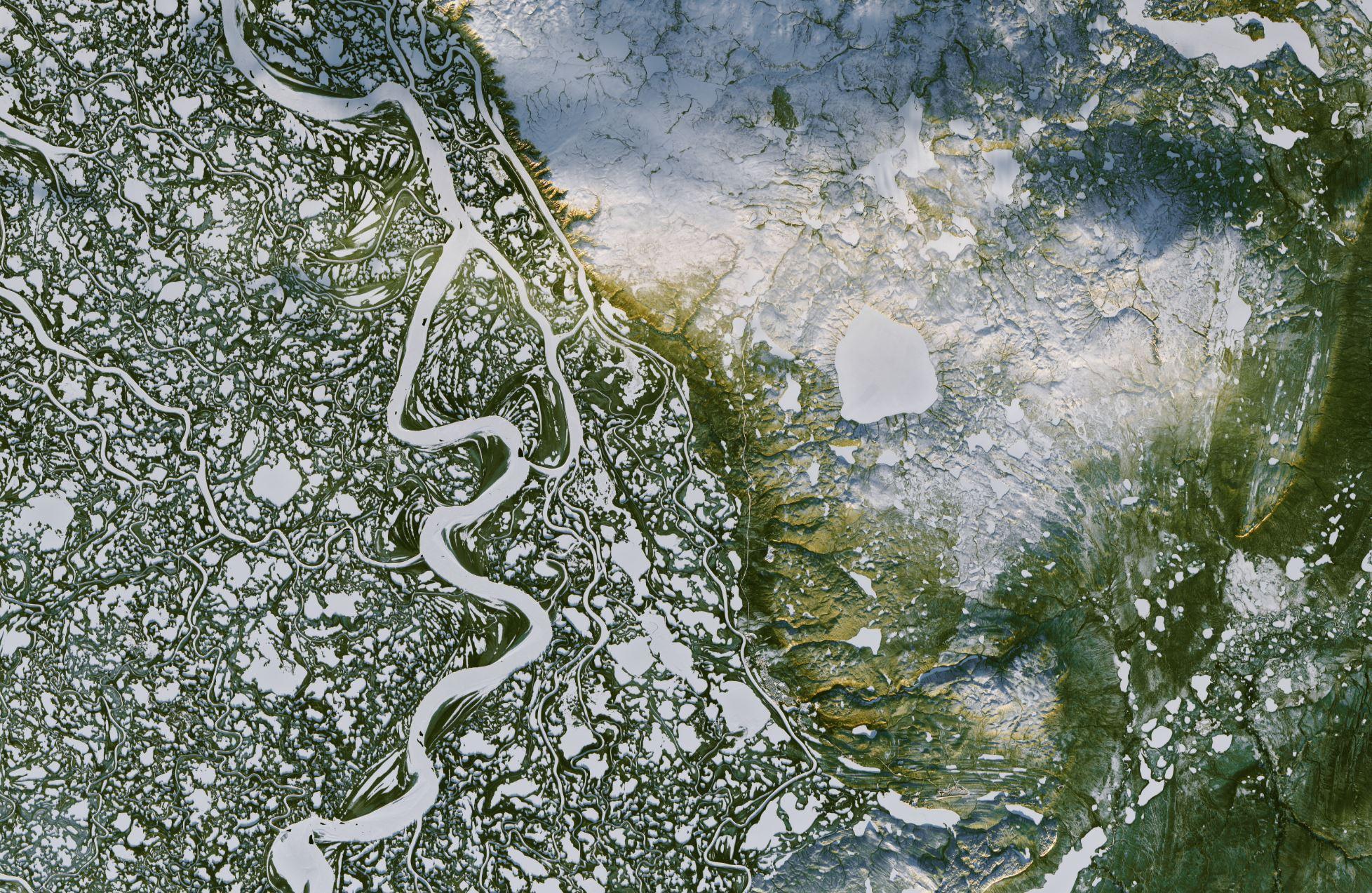 Image Credit: NASA Earth Observatory images by Joshua Stevens, using Landsat data from the  U.S. Geological Survey - Caption: Pola Lem