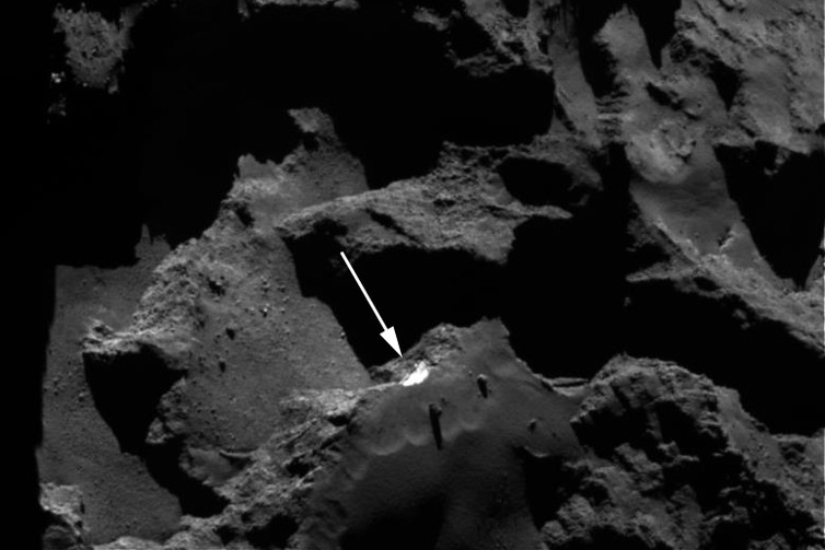OSIRIS NAC image. The white arrow shows the Aswan cliff with water ice exposed. - Image Credit: ESA/Rosetta/MPS for OSIRIS Team MPS/UPD/LAM/IAA/SSO/INTA/UPM/DASP/IDA