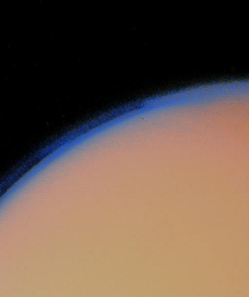 Saturn's moon Titan lies under a thick blanket of orange haze in this Voyager 1 picture. - Image Credit: NASA