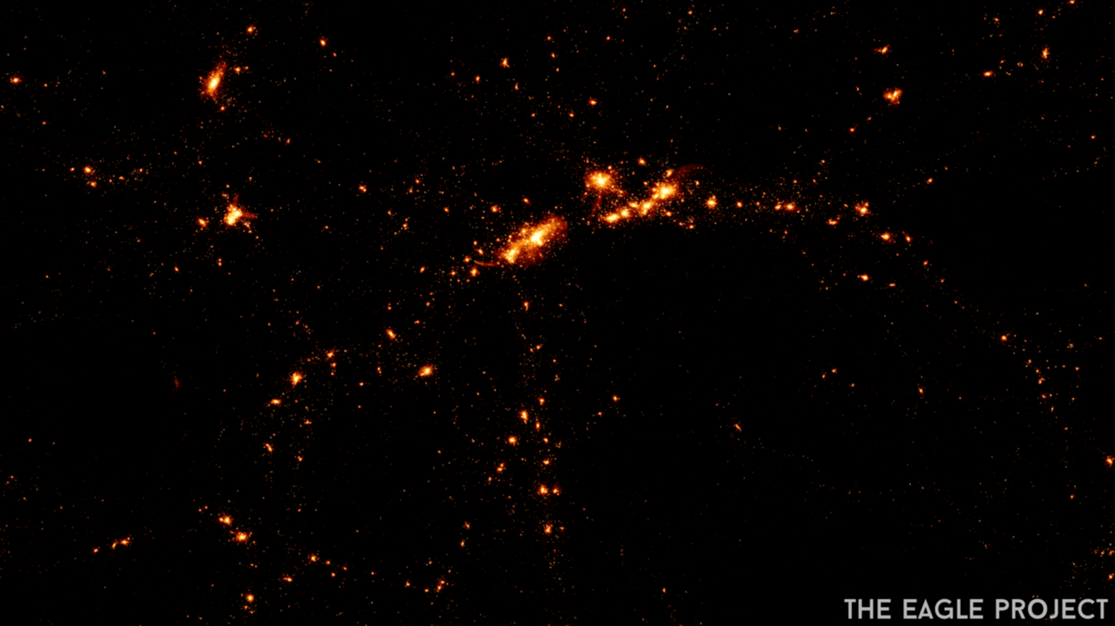 Numerical visualizations of the stars in galaxies forming in the early universe. - Image Credit: The Eagle Project, Durham University, CC BY-ND