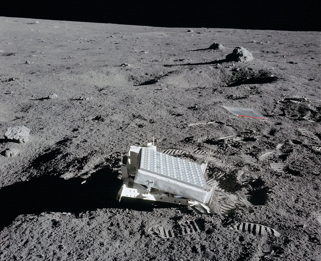 The Lunar Laser Ranging Experiment placed on the Moon by the Apollo 14 astronauts. Observatories beam a laser to the small array, which reflects a bit of the light back. Measuring the time delay yields the Moon's distance to within about a millimeter. At the Moon's surface the laser beam spreads out to 4 miles wide and only one photon is reflected back to the telescope every few seconds. - Image Credit: NASA