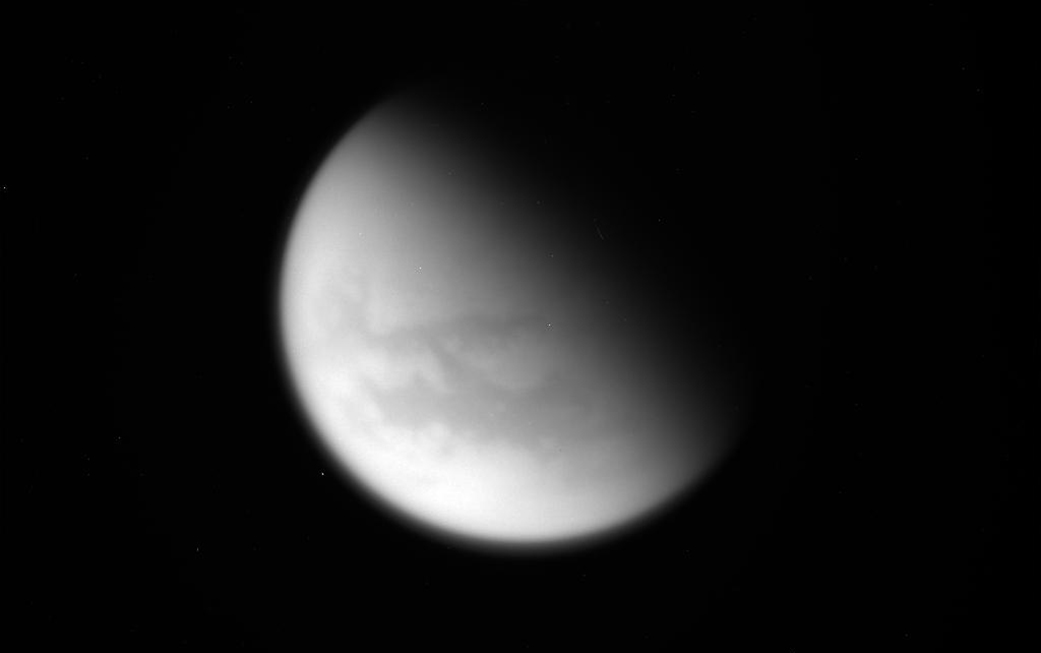 This unprocessed image of Saturn's moon Titan was captured by NASA's Cassini spacecraft during its final close flyby of the hazy, planet-sized moon on April 21, 2017. - Image Credits: NASA/JPL-Caltech/Space Science Institute