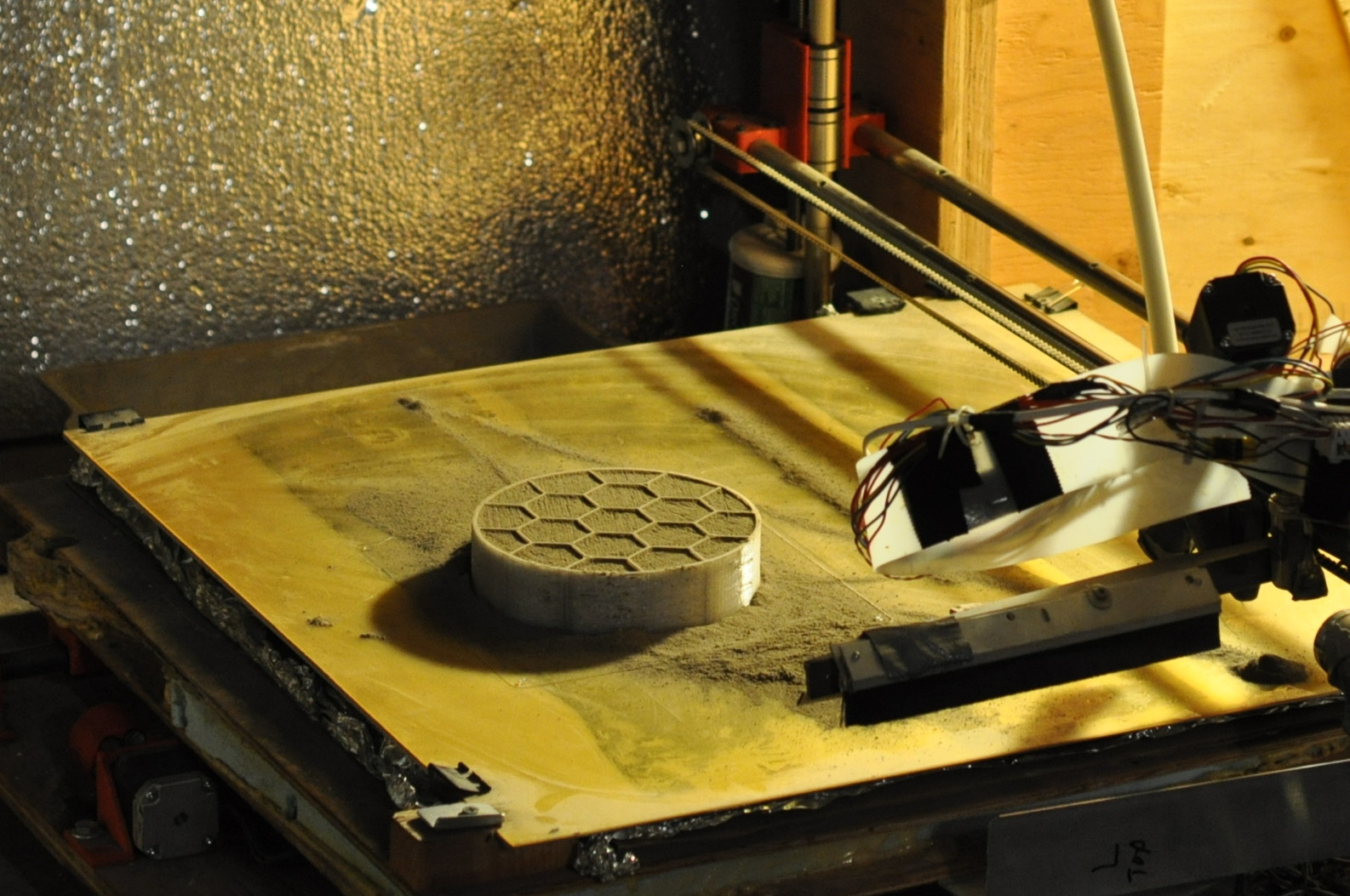 A 3D printer created by the University of Alaska team prints a cone for their entry in the Level 2, Phase 1 Compression Test Competition of NASA's 3D-Printed Habitat Competition. The university was awarded $14,070 for this stage of the challenge. - Image Credits: Courtesy of University of Alaska