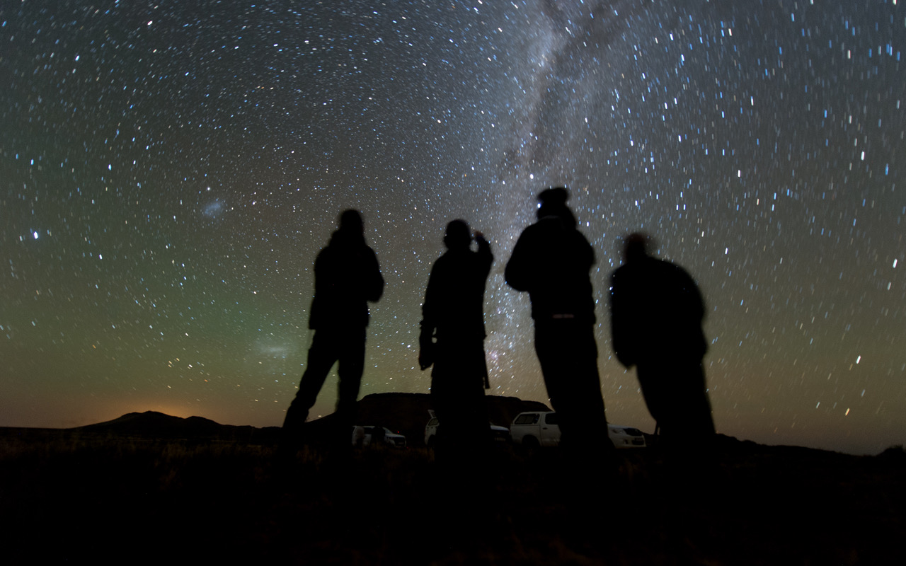 Four members of the New Horizons' South African observation team scan the sky while waiting for the start of the 2014 MU69 occultation, early on the morning of June 3, 2017. - Image Credits: NASA/JHUAPL/SwRI/Henry Throop