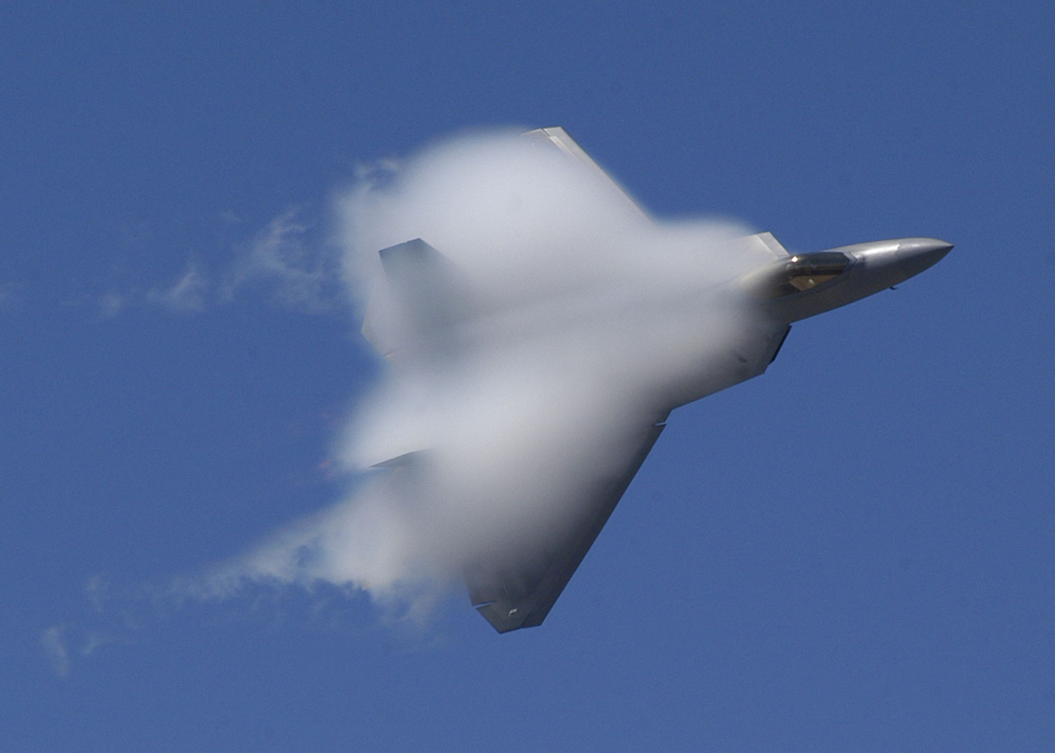 An F-22 Raptor reaching a velocity high enough to achieve a sonic boom. - Image Credit: Jason R. Williams/WikimediaCommons