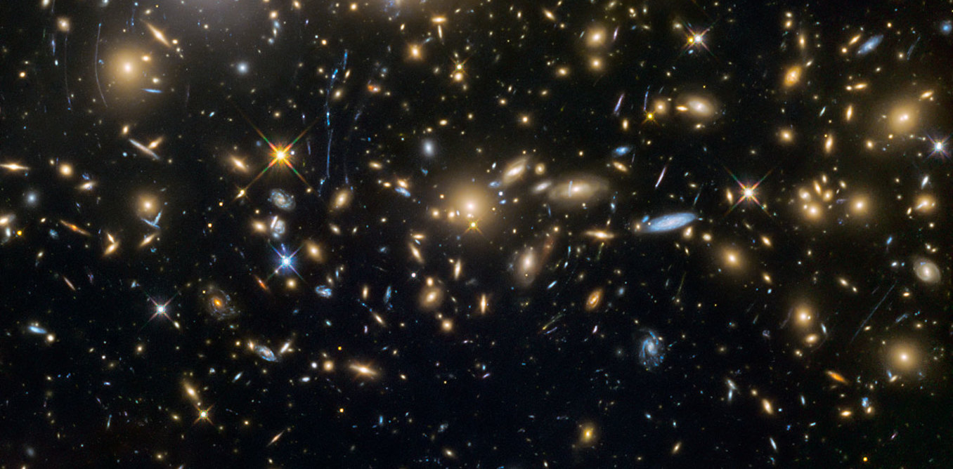 Some of the earliest known galaxies in the universe, seen by the Hubble Space Telescope. - Image Credit: NASA/ESA