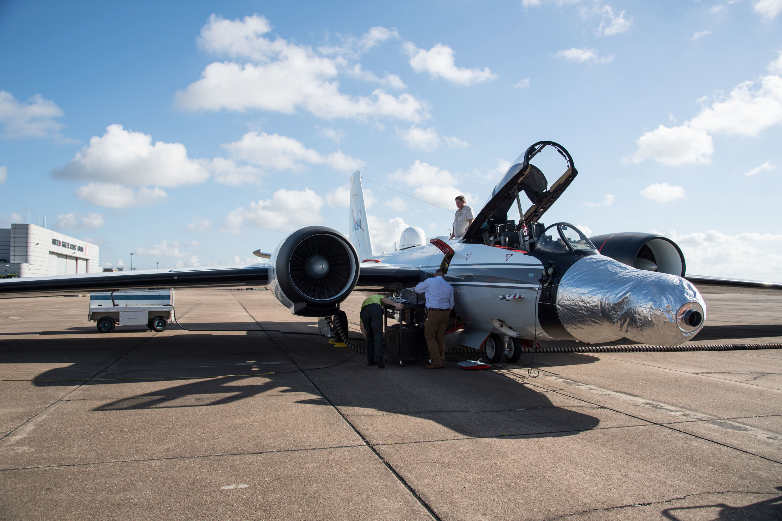 One of the WB-57F jets is readied for a test run at NASA's Johnson Space Center in Houston. The instruments are mounted under the silver casing on the nose of the plane. - Image Credits: NASA's Johnson Space Center/Norah Moran