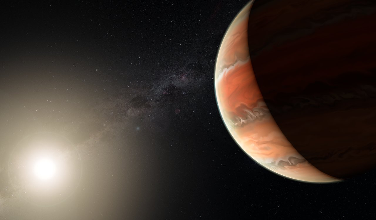 An artist's impression showing the exoplanet WASP-19b, in which atmosphere astronomers detected titanium oxide for the first time. In large enough quantities, titanium oxide can prevent heat from entering or escaping an atmosphere, leading to a thermal inversion — the temperature is higher in the upper atmosphere and lower further down, the opposite of the normal situation. - Image Credit: ESO/M. Kornmesser (click to enlarge)
