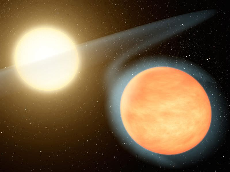 An artist's impression of WASP 12-b being slowly consumed as a result of its ridiculously tight orbit around its star. - Image Credit: NASA.
