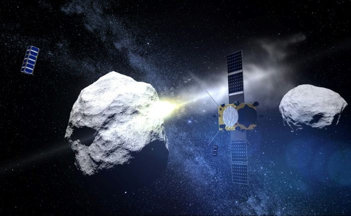 A computer generated handout image released by the European Space Agency shows the impact of the DART (Double Asteroid Redirection Test) projectile on the binary asteroid system (65803) Didymos. - Image Credit: ESA/AFP