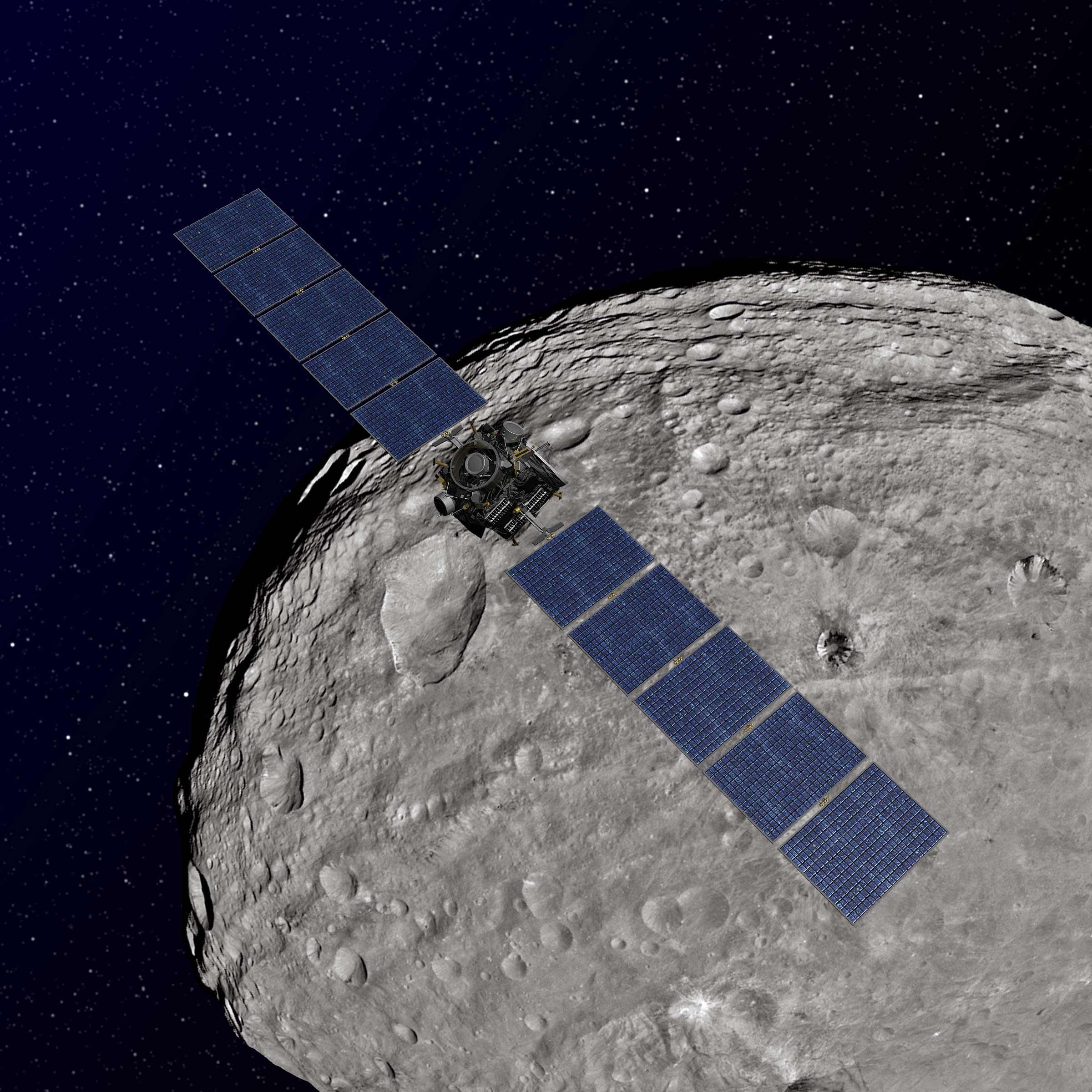 Artist rendition of Dawn spacecraft orbiting Vesta. Credit: NASA/JPL-Caltech