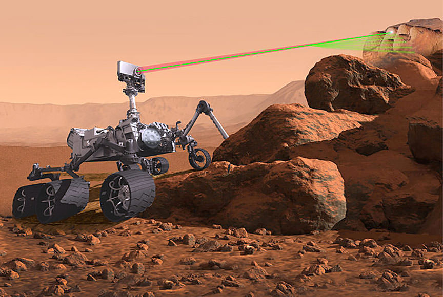 The microphone for the upcoming Mars mission will be attached to the SuperCam, seen here in this illustration zapping a rock with its laser. - Image Credit: NASA/JPL-Caltech