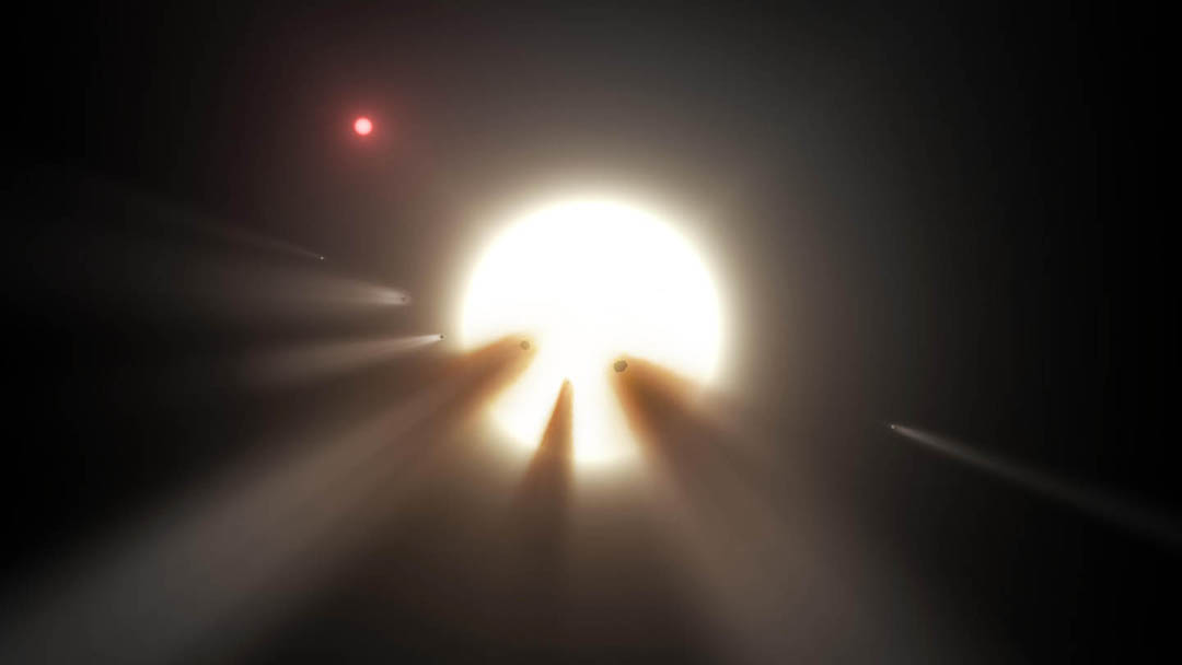 Artist's impression of an orbiting swarm of dusty comet fragments around Tabby's Star. - Image Credit: NASA/JPL-Caltech