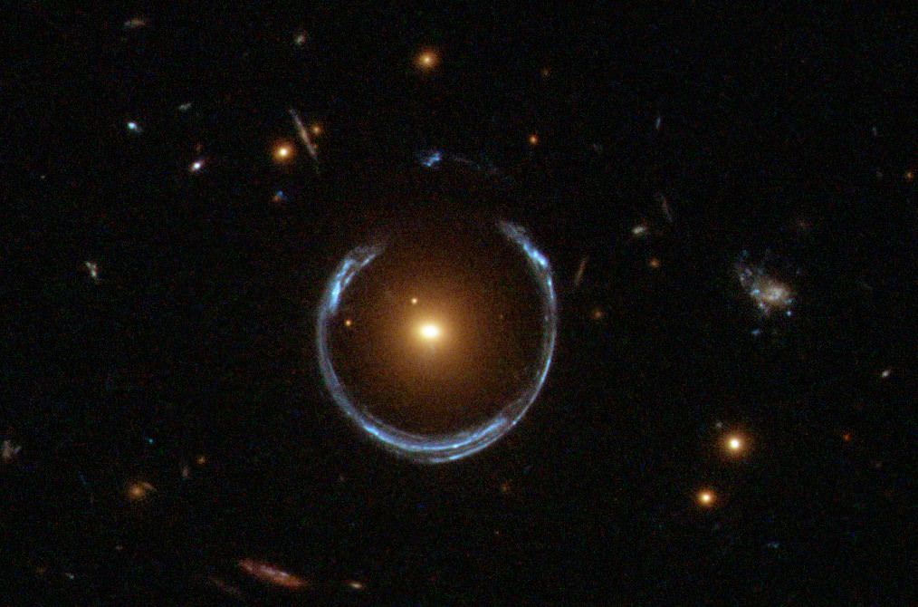 The notable gravitational lens known as the Cosmic Horseshoe is found in Leo. - Image Credit: NASA/ESA/Hubble