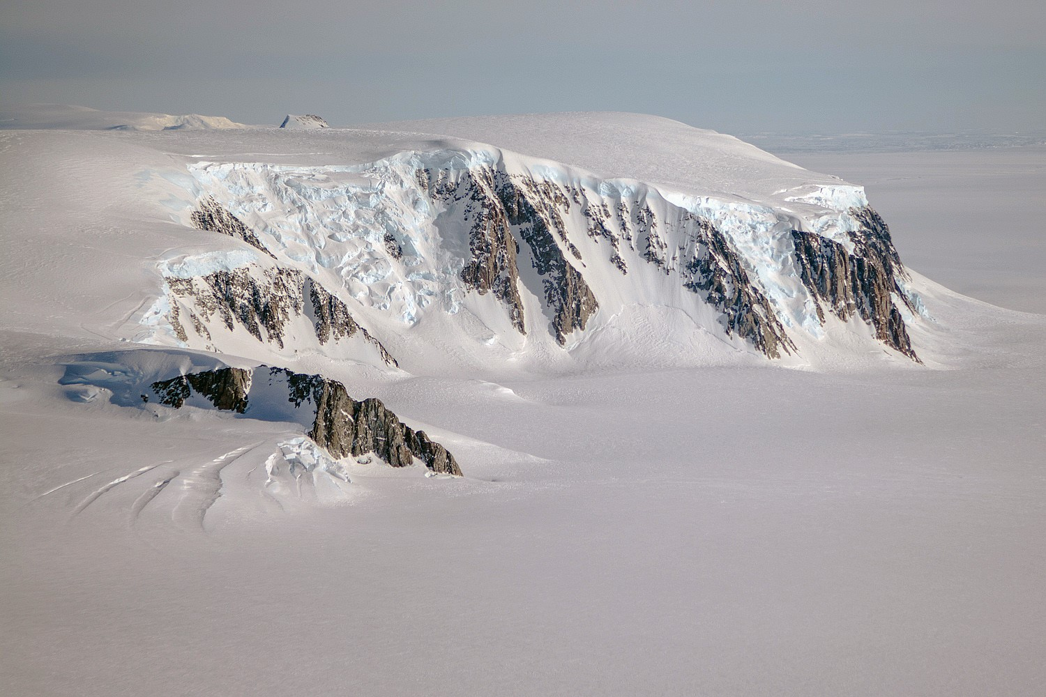 A view of mountains and glaciers in Antarctica's Marie Byrd Land seen during the Nov. 2nd, 2014, IceBridge survey flight. - Image Credit: NASA / Michael Studinger