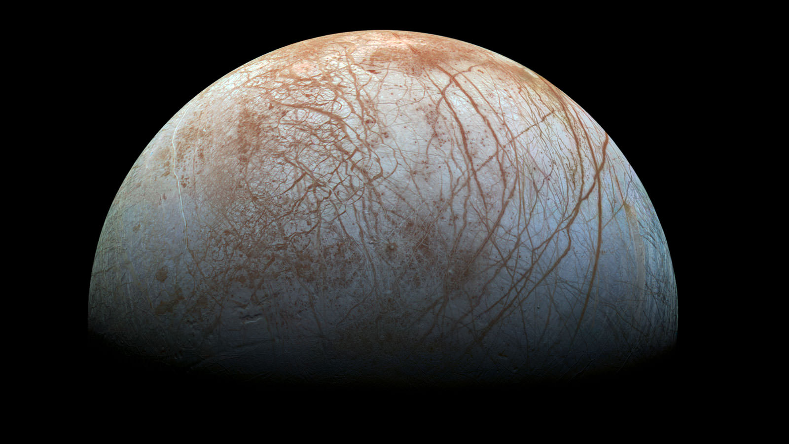 """A """"true color"""" image of the surface of Jupiter's moon Europa as seen by the Galileo spacecraft. - Image credit: NASA/JPL-Caltech/SETI Institute"""