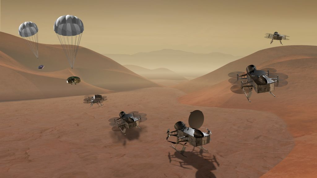 In this illustration, the Dragonfly helicopter drone is descending to the surface of Titan. - Image Credit:NASA