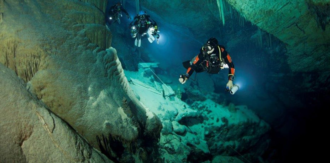 Author Tom Iliffe leads scientists on a cave dive. - Image Credit: Jill Heinerth , CC BY-ND