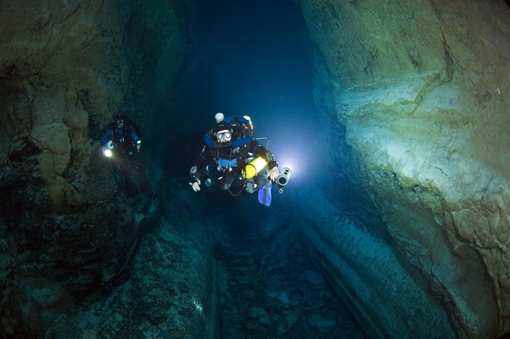 Tom Iliffe diving with his Megalodon closed-circuit rebreather in a lava tube cave in the Canary Islands. - Image Credit: Jill Heinerth, CC BY-ND