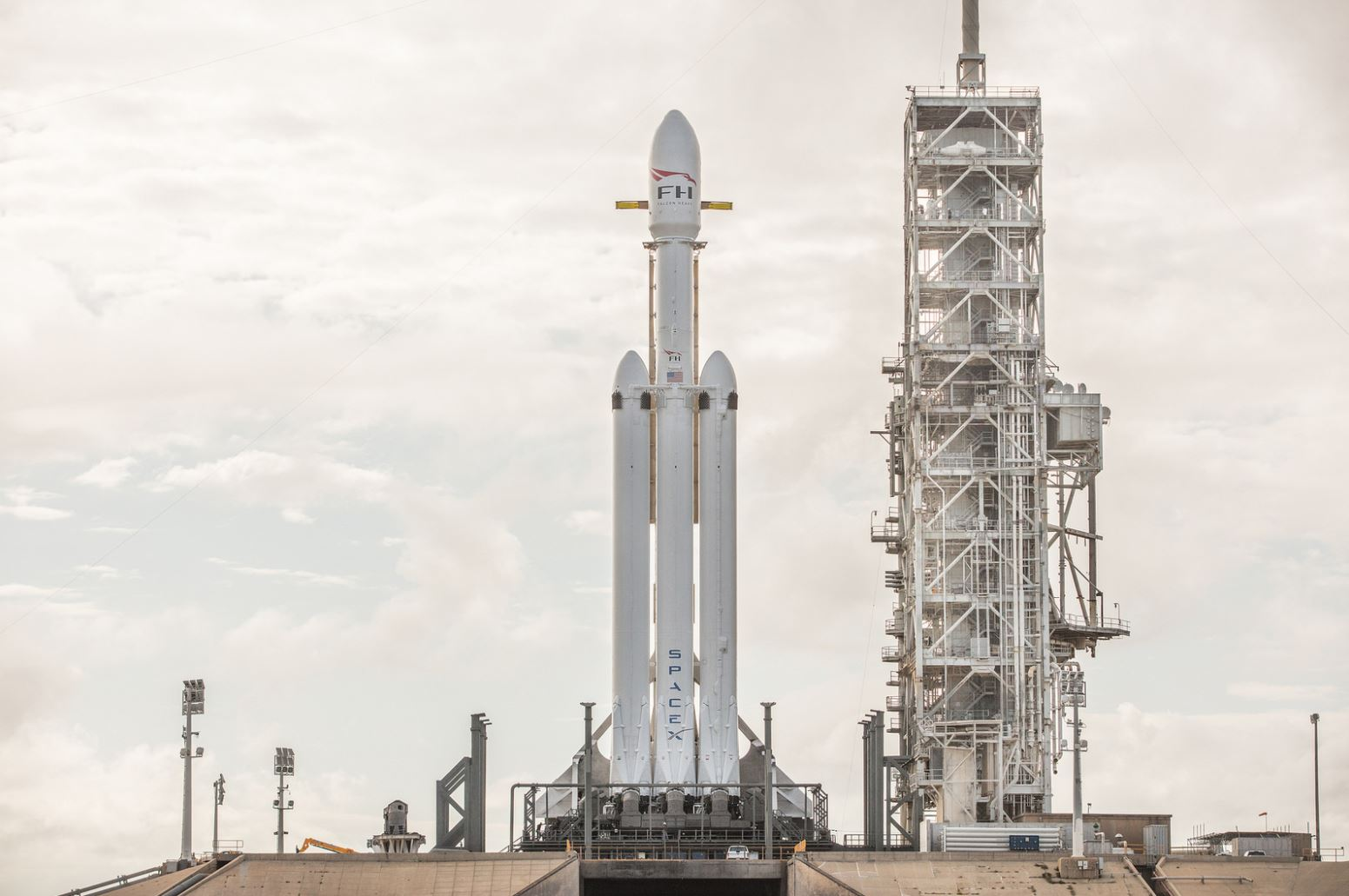 A stunning view of the Falcon Heavy at it's launchpad -  Image Credit: SpaceX via flickr