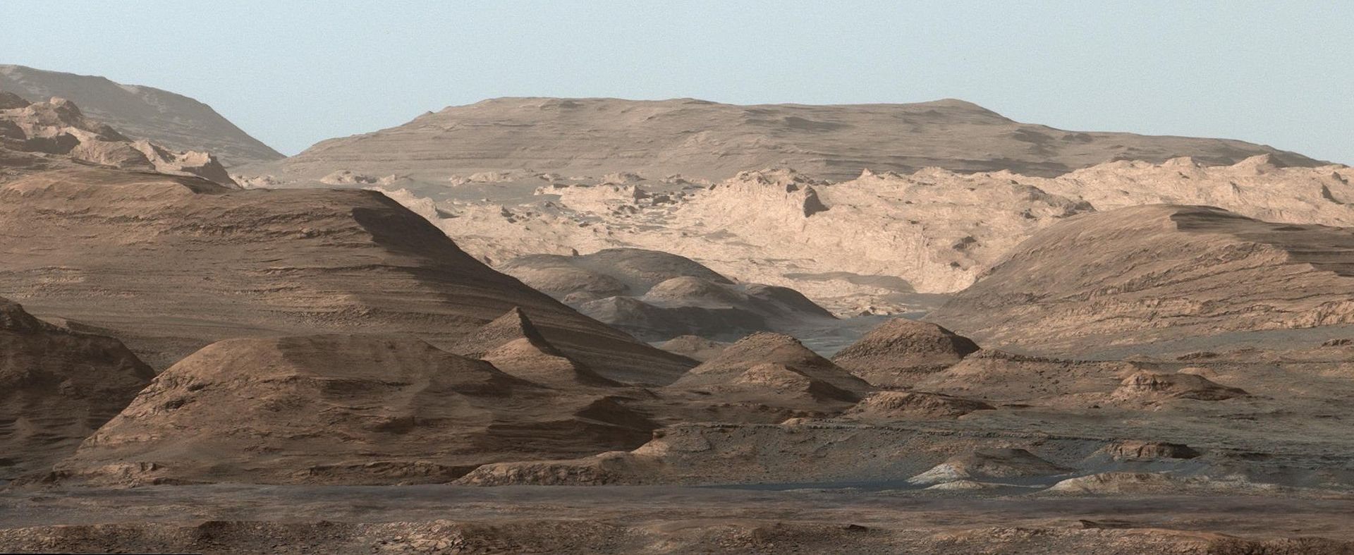 Image of Mount Sharp taken by the Curiosity rover on Aug. 23rd, 2012. The layers at the base of Mt. Sharp show the geological history of Mars. - Image Credit: NASA/JPL-Caltech/MSSS.