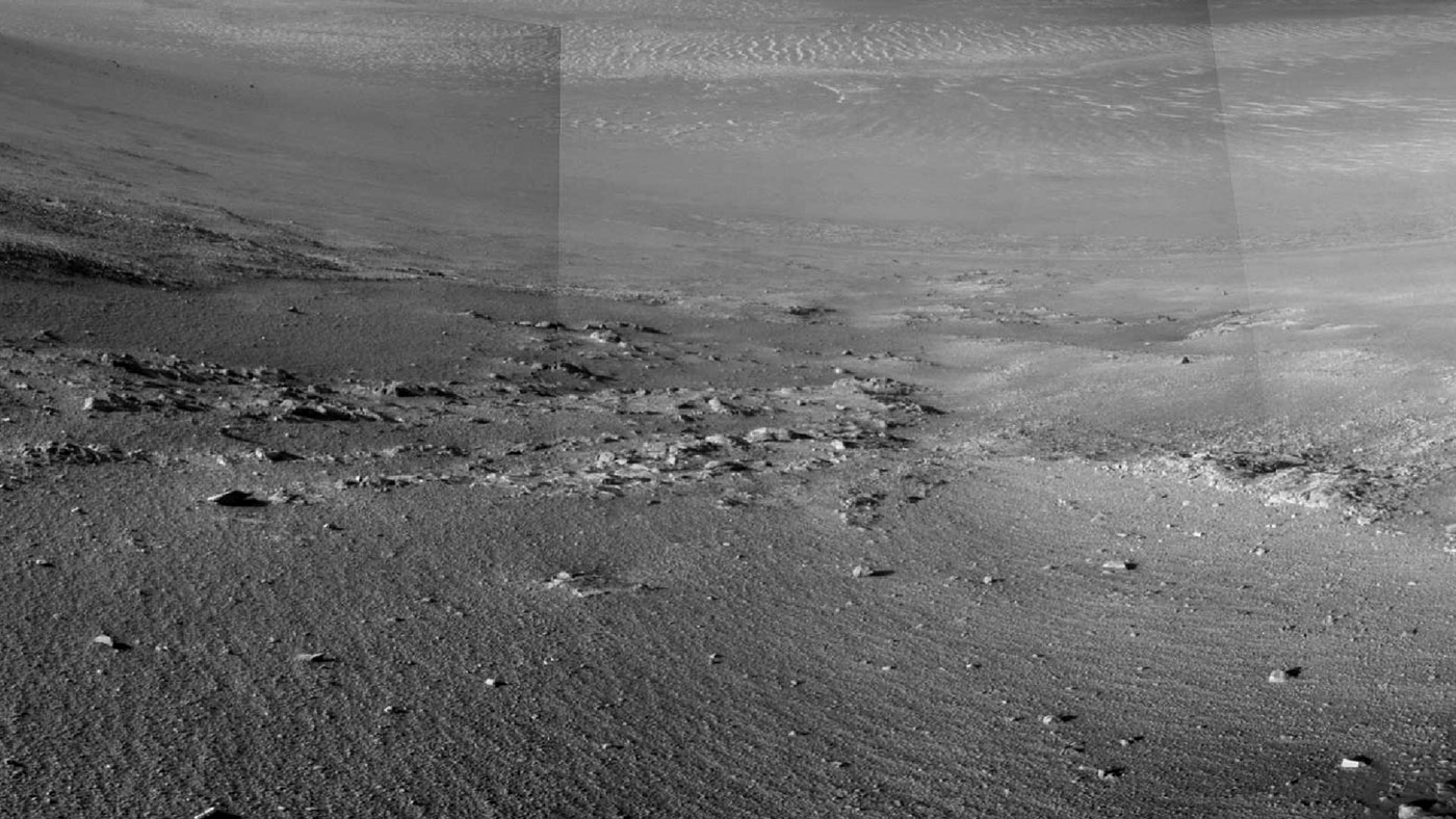 """Textured rows on the ground in this portion of """"Perseverance Valley"""" are under investigation by NASA's Mars Exploration Rover Opportunity, which used its Navigation Camera to take the component images of this downhill-looking scene. The rover reaches its 5,000th Martian day, or sol, on Feb. 16, 2018. - Image Credit: NASA/JPL-Caltech"""