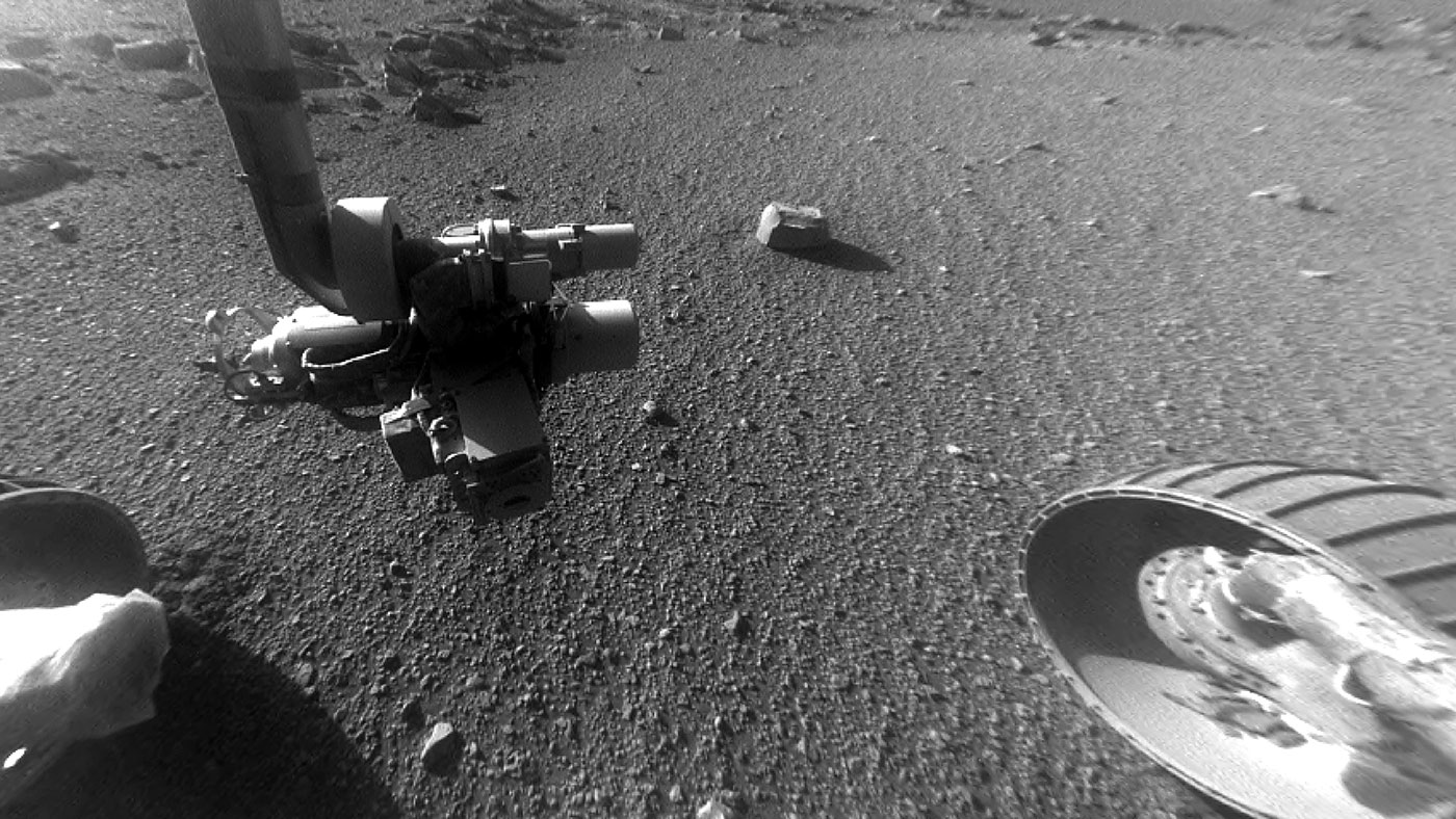 This late-afternoon view from the front Hazard Avoidance Camera on NASA's Mars Exploration Rover Opportunity shows a pattern of rock stripes on the ground, a surprise to scientists on the rover team. It was taken in January 2018, as the rover neared Sol 5000 of what was planned as a 90-sol mission. - Image Credit: NASA/JPL-Caltech