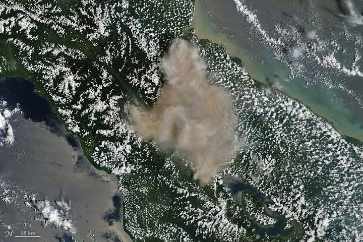 The Eruption of Sinabung Volcano, Indonesia, as seen from space. - Image Credit: NASA Earth Observatory.