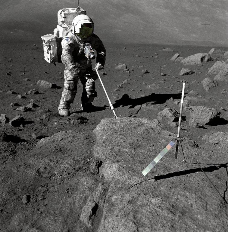 Geologist and astronaut Harrison Schmitt, Apollo 17 lunar module pilot, pictured using an adjustable sampling scoop to retrieve lunar samples during the Apollo 17 mission in December 1972. - Image Credit: NASA. (click to enlarge)