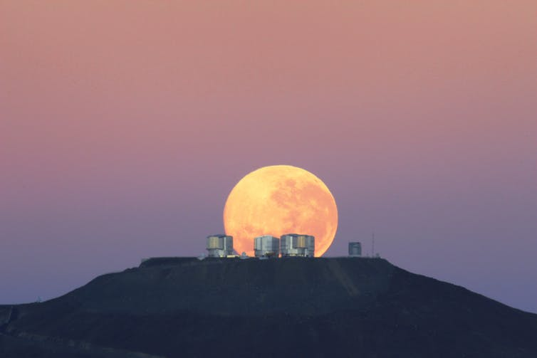 Moonset over the Very Large Telescope. - Image Credit: G.Gillet/ESO,  CC BY-SA .