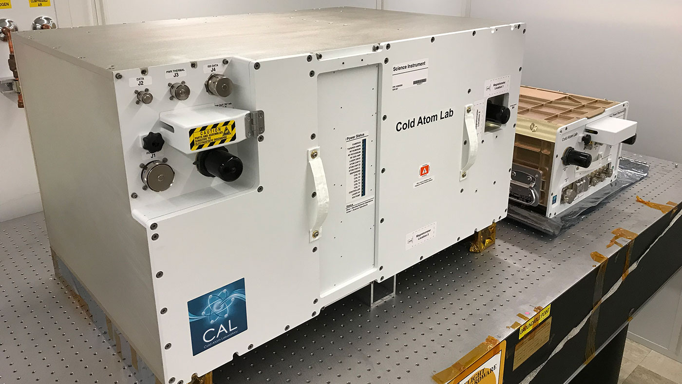 "The Cold Atom Laboratory (CAL) consists of two standardized containers that will be installed on the International Space Station. The larger container is called a ""quad locker,"" and the smaller container is called a ""single locker."" The quad locker contains CAL's physics package, or the compartment where CAL will produce clouds of ultra-cold atoms. - Image Credits: NASA/JPL-Caltech/Tyler Winn"