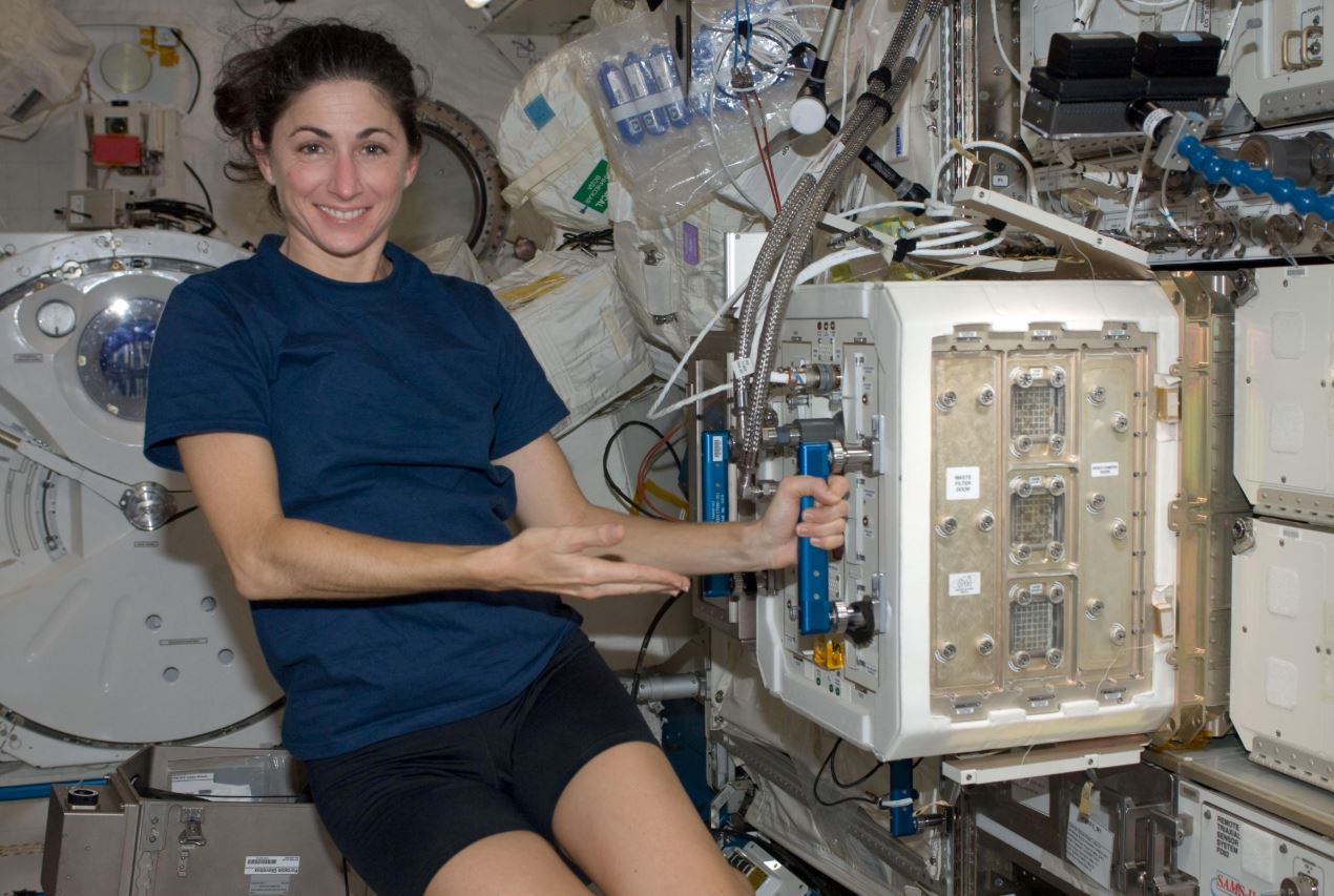 NASA astronaut Nicole Stott, Expedition 20/21 flight engineer, is pictured near the Mice Drawer System (MDS) in the Kibo laboratory of the International Space Station. - Image Credit: NASA