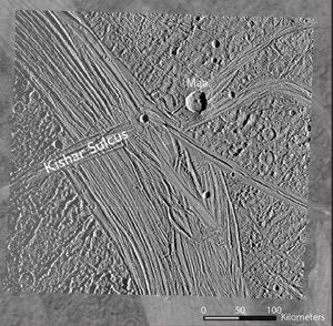 A higher-resolution Galileo image of Ganymede overlayed on a grainier Voyager image. The strike fault Kishar Sulcus is labelled. It intersects another feature called Tiamat Sulcus, running across Kishar Sulcus. - Image Credit: NASA, Cameron et al. 2018