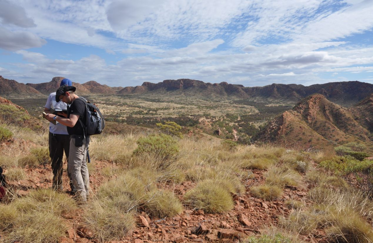Scientists working at the central peak of Gosses Bluff meteorite crater in Northern Territory. Nick Timms , Author provided