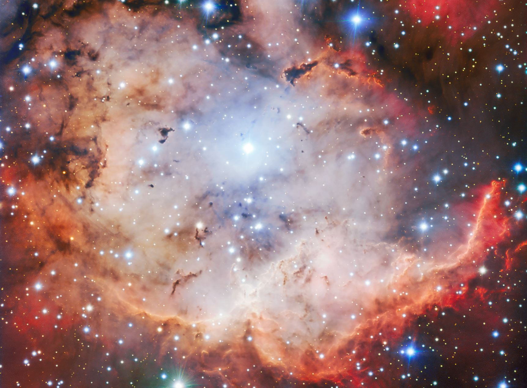 This vivid picture of an active star forming region — NGC 2467, otherwise known as the Skull and Crossbones nebula — is as sinister as it is beautiful. This image of dust, gas and bright young stars, gravitationally bound into the form of a grinning skull, was captured with the  FORS  instrument on  ESO 's  Very Large Telescope  (VLT). Whilst ESO's telescopes are usually used for the collection of science data, their immense resolving power makes them ideal for capturing images such as this — which are beautiful for their own sake. - Image Credit: ESO