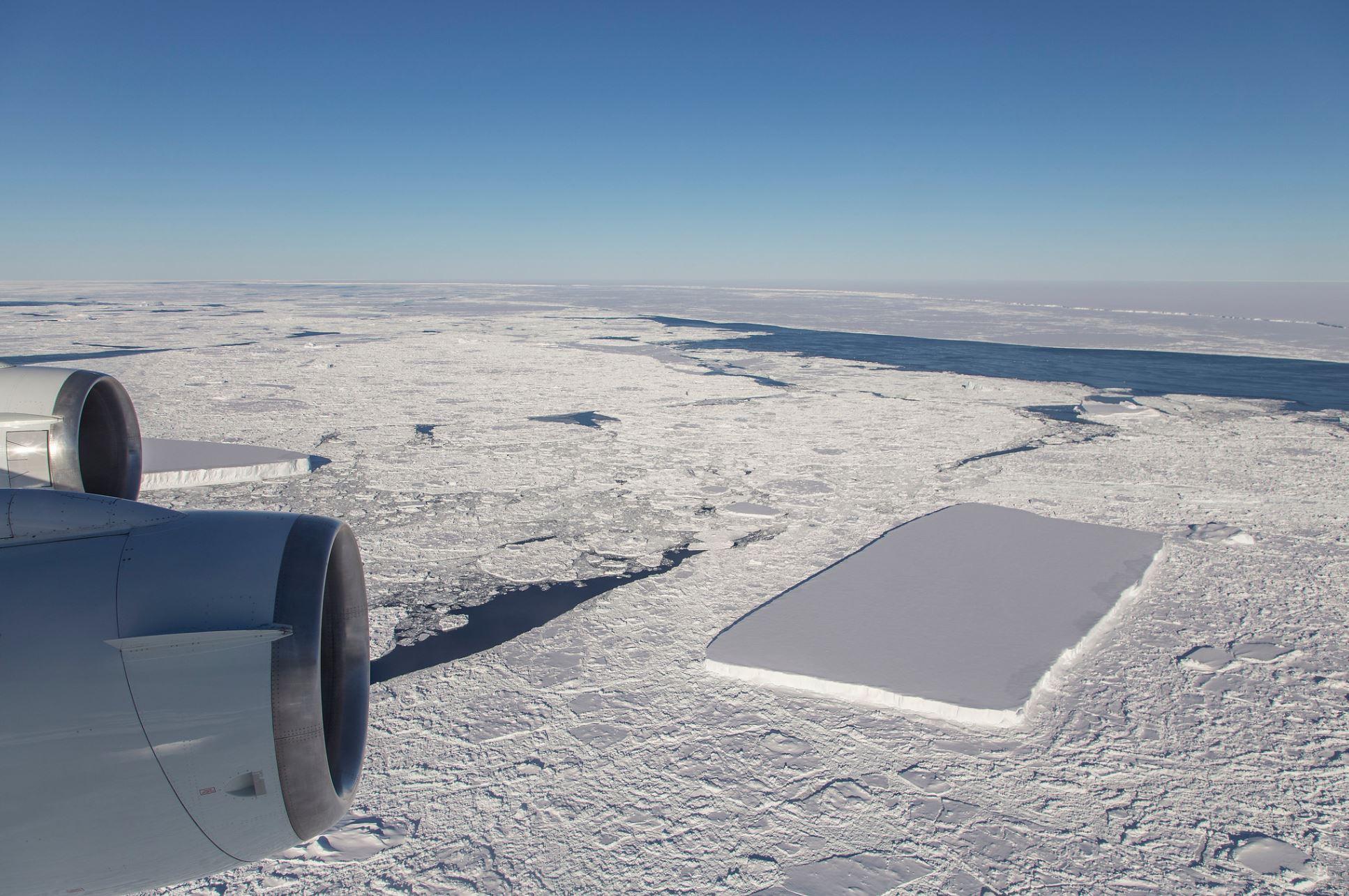 Aerial shot shot of the rectangular iceberg found off the Larsen 3 ice shelf. - Image Credit: NASA/Jeremy Harbeck