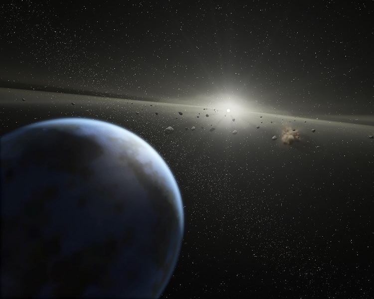 Artist's impression of a massive asteroid belt in orbit around a star. Earth's water may not have all come from asteroids and comets, so maybe that's true for exoplanets. - Image Credit: NASA-JPL / Caltech / T. Pyle (SSC)