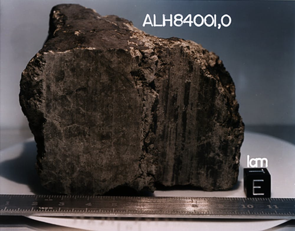 A 4.5 billion-year-old rock, labeled meteorite ALH84001, identified from Mars. - Image Credit:  NASA/JSC/Stanford University