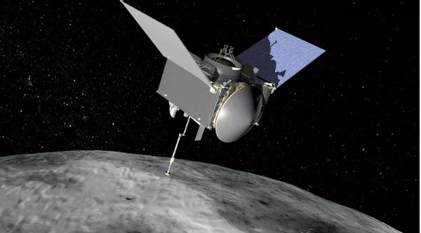 This artist's concept shows the OSIRIS-REx spacecraft approaching the asteroid Bennu.- Image Credit: NASA