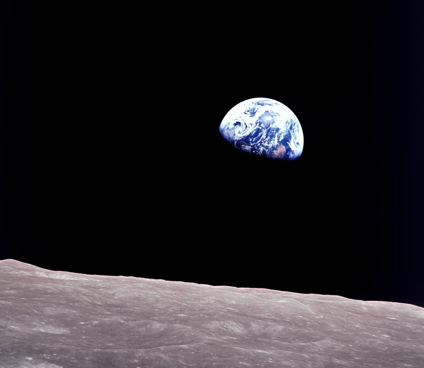 Earthrise: astronauts aboard Apollo 8 captured this spectacular photo of Earth rising above the lunar horizon as they emerged from behind the dark side of the Moon. - Image Credit:  NASA