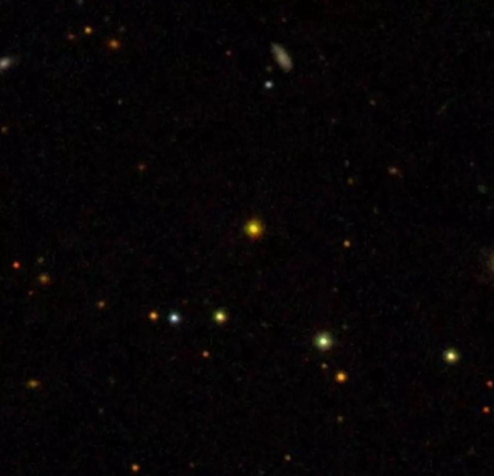 With a big enough telescope you can see quasar APM 08279+5255 and look 12 billion years back in time. - Image Credit:  Sloan Digital Sky Survey ,  CC BY