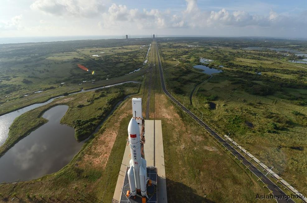 The first Long March 5 rocket being rolled out for launch at Wenchang in late October 2016. - Image Credit: Su Dong/China Daily