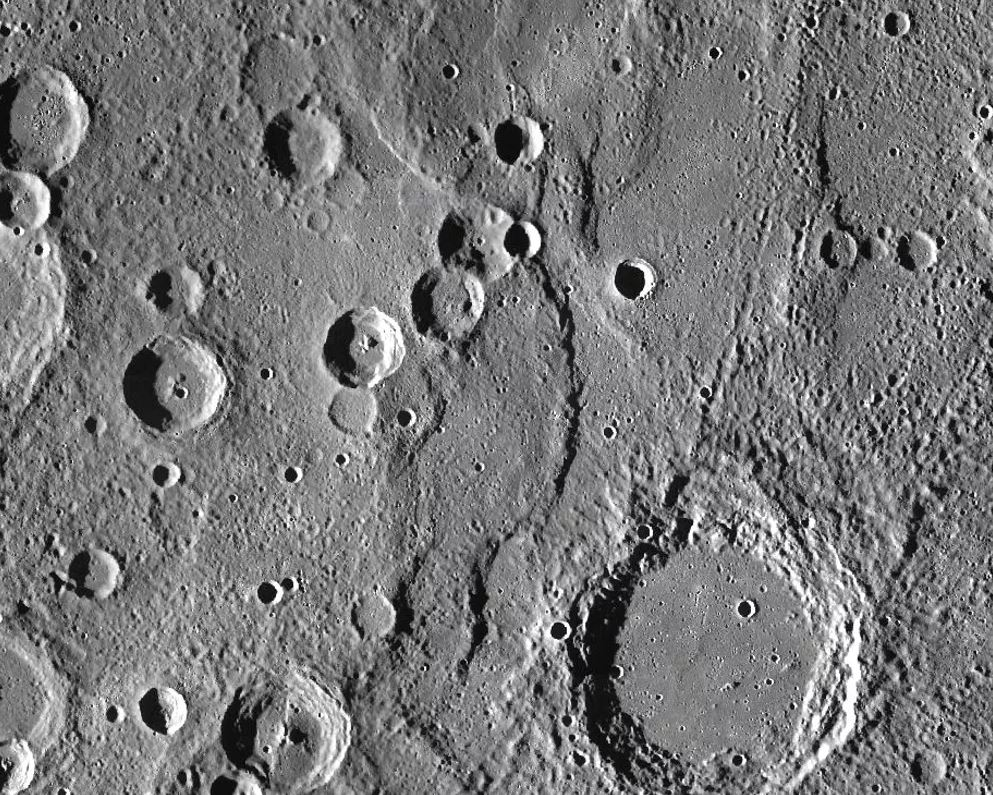 Endeavour Rupes, the shadowed escarpment in the middle of a 400km wide view of Mercury. - Image Credit: NASA/JHUAPL/CIW