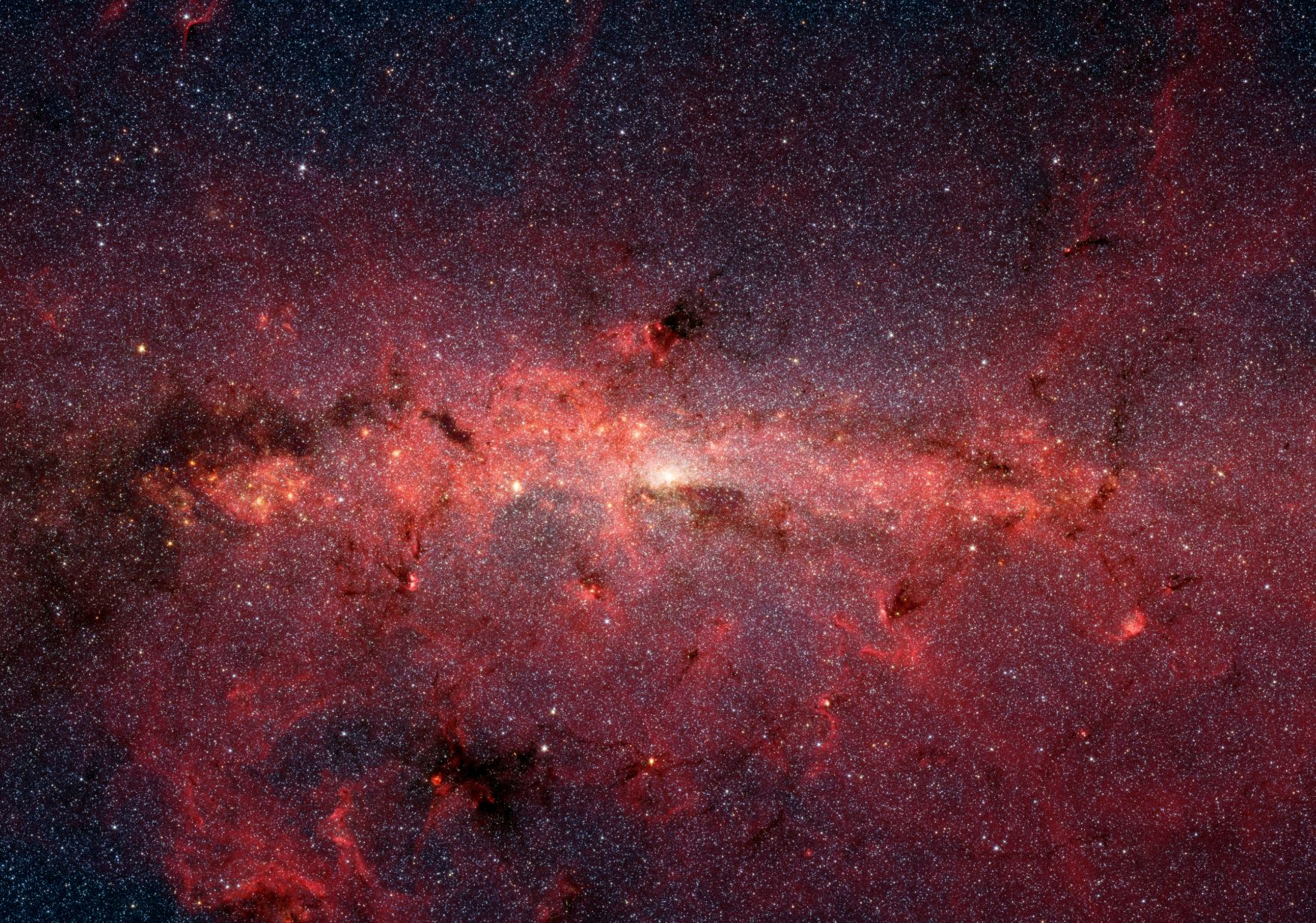 Our galactic core - Image Credit:  NASA/JPL-Caltech/S. Stolvy (SSC/Caltech) via Wikimedia Commons