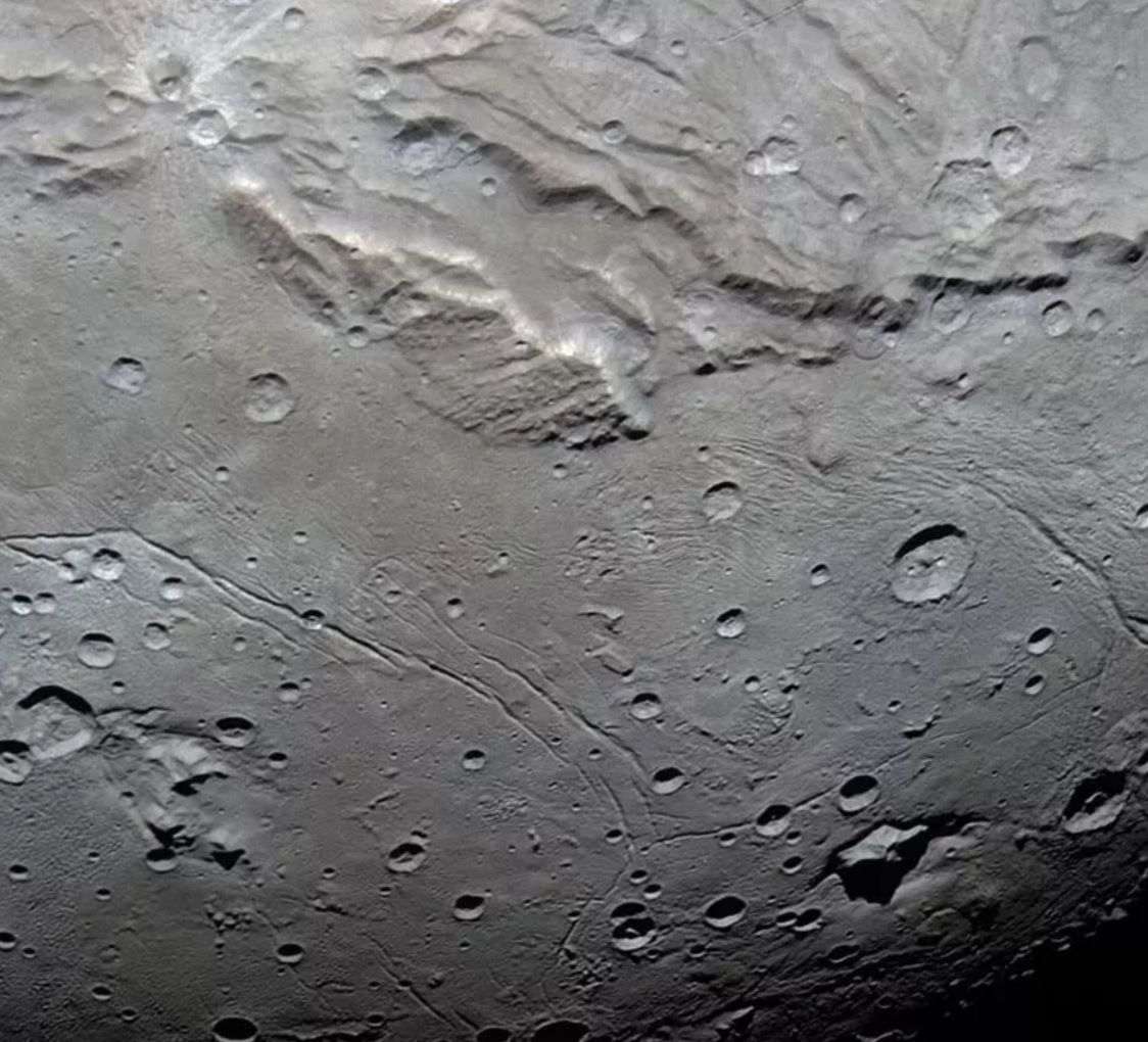 Detail of Charon's Vulcan Planitia, where small craters are deficient in numbers. - Image Credit:  NASA/Johns Hopkins University Applied Physics Laboratory/Southwest Research Institute