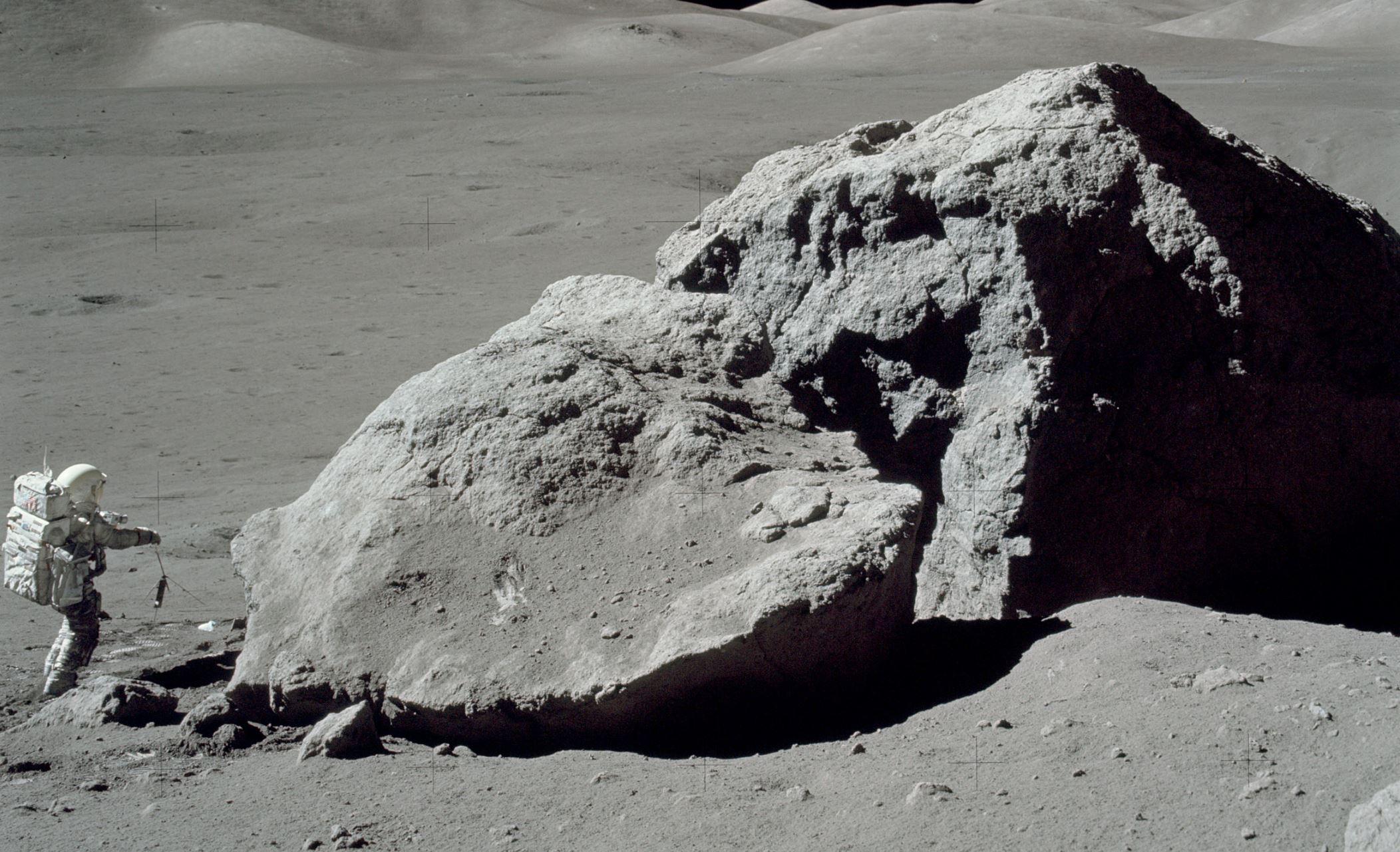 Apollo 17 astronaut Harrison H. Schmitt standing beside a boulder on the lunar surface. - Image Credit: NASA