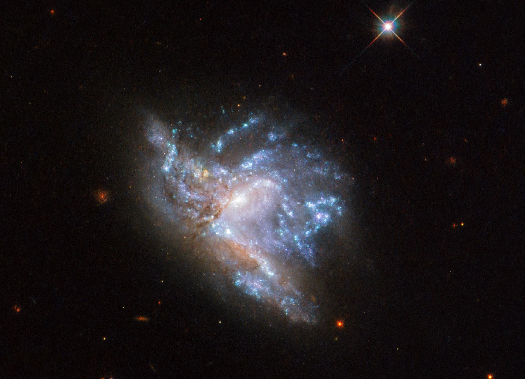 Located in the constellation of Hercules , about 230 million light-years away, NGC 6052 is a pair of colliding galaxies.- Image Credits: ESA/Hubble & NASA, A. Adamo et al.