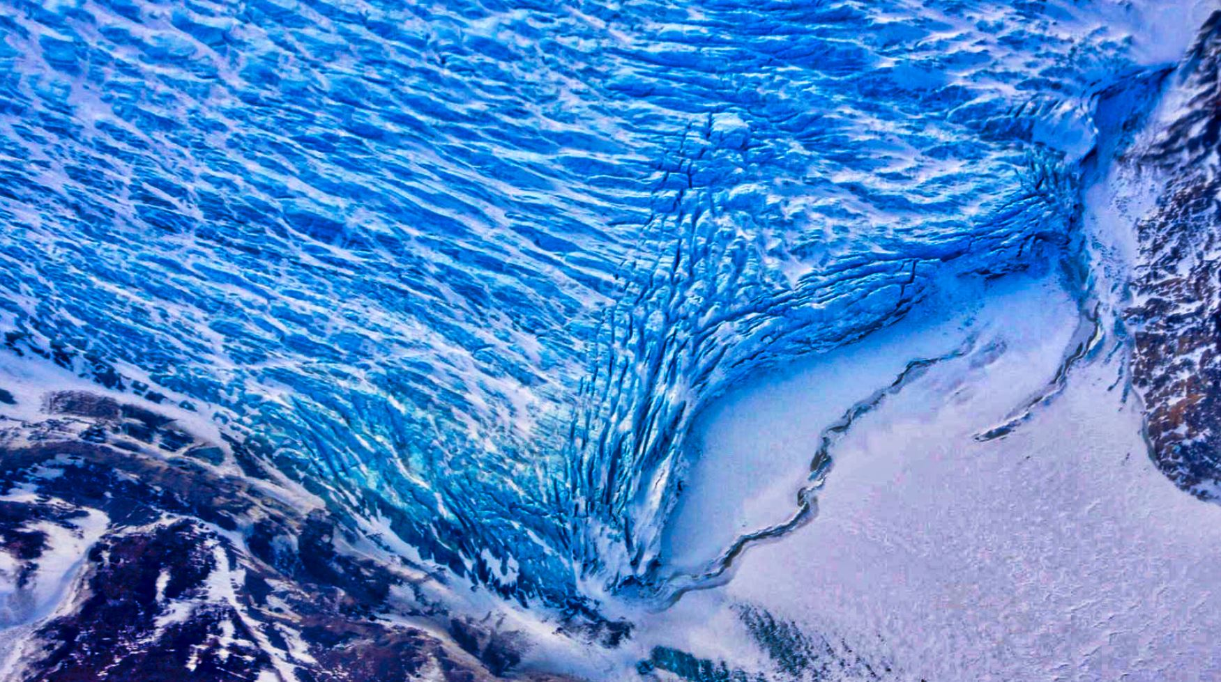 Cracks in the front of a glacier as it reaches the ocean. - Image Credit: NASA/Adam Klein - hdr edit by Universal-Sci