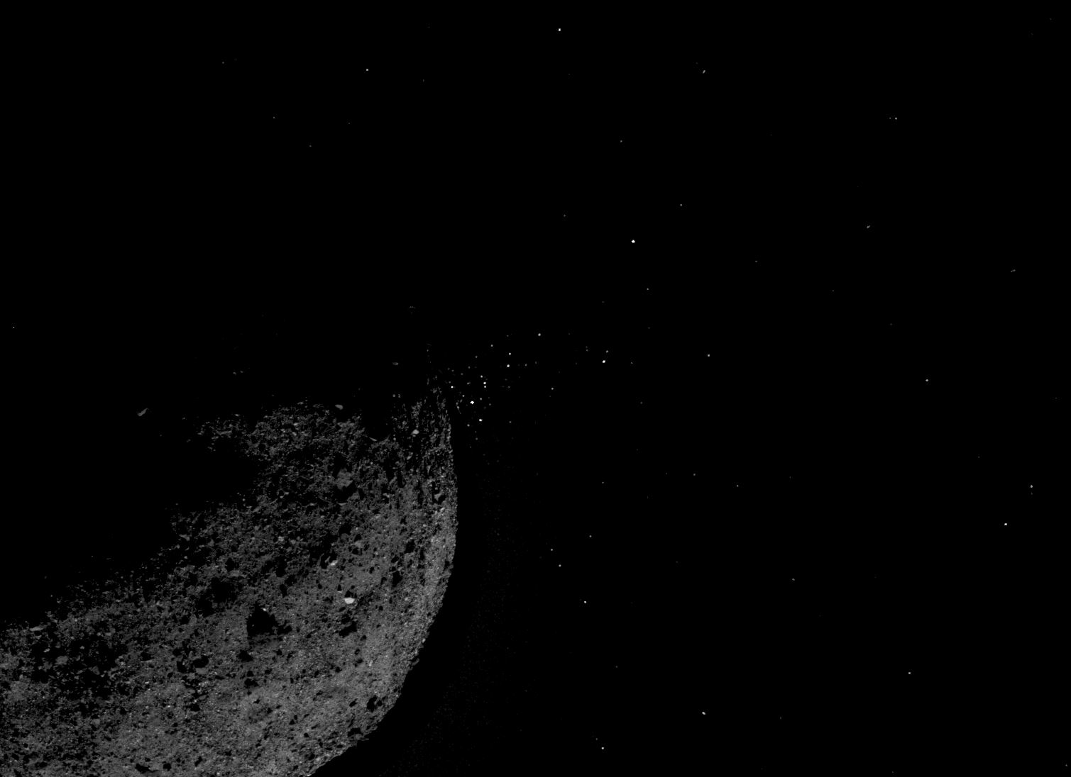 This view of asteroid Bennu ejecting particles from its surface on January 19 was created by combining two images taken on board NASA's OSIRIS-REx spacecraft. Other image processing techniques were also applied, such as cropping and adjusting the brightness and contrast of each image. - Image Credit: NASA/Goddard/University of Arizona/Lockheed Martin